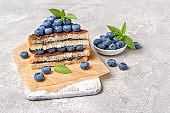 Toast bread with chocolate spread, pine nuts, fresh blueberries and mint