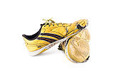 Old  worn out futsal sports shoes on white background soccer sportware object isolated