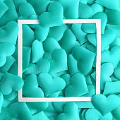 Love concept made of small hearts in turquoise color and frame abstract.