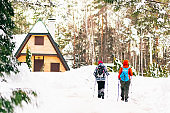 Hiking at winter mountains. Sport and recreation concept.