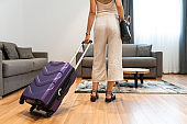 Woman arriving in hotel room