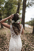 Beautiful bride in wedding dress with floral crown