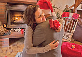 Woman in man embrace holding red gift box