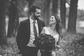 Happy bride and groom, beautiful wedding couple outdoors