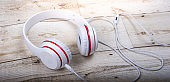The white headphones are red on the wood floor. Leisure technology