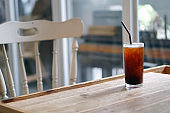 Iced americano - A glass of black coffee on table and copy space.