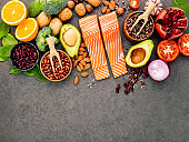 Ingredients for the healthy foods selection on dark background. Balanced healthy ingredients of unsaturated fats and fiber for the heart and blood vessels.