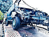 Mangled car involved in a road accident on a motorway