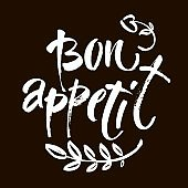 Bon appetit card. Hand drawn lettering background. Ink illustration. Modern brush calligraphy. Isolated on black background.