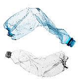 Crushed plastic bottles isolated on white background
