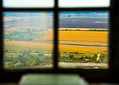 view through window glass on beautiful fields
