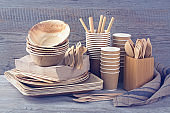 Disposable tableware on a grey background