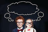Children little boy and girl with speech bubble cloud