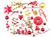 Gold and red Christmas decorations on white background. Xmas composition flat lay top view