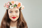 Closeup Beauty Portrait of Beautiful Model with Healthy Hair, Makeup and Flowers Wreath. Spring Beauty Woman Face