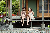 Young women relaxing in country side, lifestyle portrait