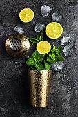 Refreshing Mojito cocktail, flat lay concept