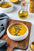 Pumpkin squash soup with seeds, olive oil