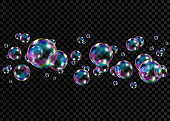 Colorful soap  bubbles with rainbow reflection.