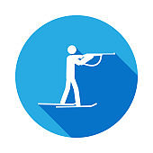 Silhouette biathlon athlete shooting athlete isolated icon with long shadow. Winter sport games discipline signs and symbols can be used for web, logo, mobile app, UI, UX