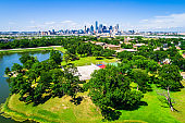 Green Landscape and Pong with Downtown Dallas Texas Skyline Cityscape in the far background 2019