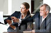 Woman Entrepreneur making a financial presentation at work