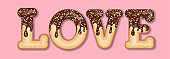 Tempting  typography. Icing text. Word 'love' glazed with chocolate and candy. Donut letters
