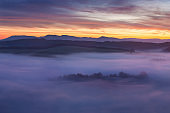 Sunrise Over Misty Landscape. Scenic View Of Foggy Morning Sky With Rising Sun Above Misty Forest. Middle Summer Nature Of Europe. Fantastic mountains landscape in Europe