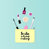 """Makeup bag with beauty products. Makeup case with the phrase: """"Smile is the best makeup"""". Vector illustration, flat design"""