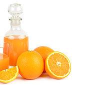 Fresh orange juice with fruits, isolated on white background.