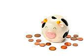 Pink piggy bank and coins, isolated on white background .