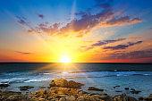 Beach of the sea and beautiful sunrise.