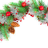 Christmas decoration baubles with branches of fir tree isolated on white background.