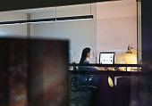 Woman sitting looking at computer in office studio