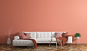 Interior of modern living room with white fabric sofa over coral wall 3d rendering