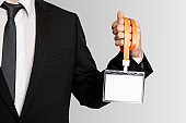 Businessman showing a white empty staff identity mockup with orange lanyard