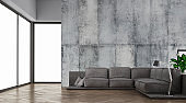 Modern living room with sofa on a side