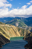 Deriner Dam is a concrete double-curved arch dam on the Coruh River in Artvin Province, Turkey.