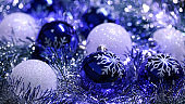 Christmas Ornament Tinsel Snowflake Decoration Ball Bauble Blue Silver White Glitter Bokeh Dust Shiny Background