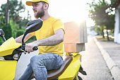Delivery Man Bringing Packages To Customers Fast On A Scooter