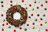 Christmas ornament and Wreath on corrugated white background