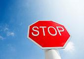 Stop traffic sign under blue sky