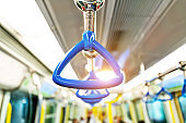 Blue handles in the bus