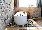 Modern bathroom with stone wall and bathtub