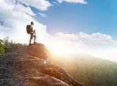 Male hiker standing on a rock of mountain peak