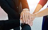 Business team joining hands, team work