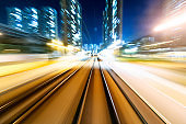 Motion blur railroad track in the city at night