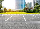 Empty parking lot in city street