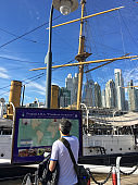 Reading information about museum ship in Puerto Madero, Buenos Aires, Argentina
