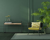Green interior with a yellow armchair